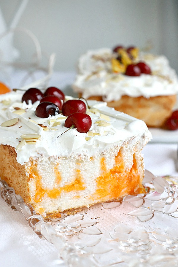 Light and delicious, Orange Angel Food cake begins with a box mix. Easy recipe for a poke cake using Jell-O and whipped topping for a refreshing dessert.