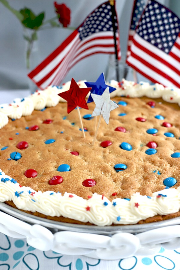 Quick, easy and festive, a giant patriotic peanut butter cookie pizza is a simple recipe the whole family will love for 4th of July or birthday celebrations.