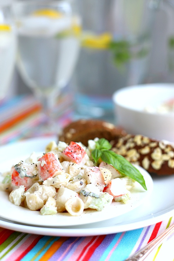 Light and easy to make, pasta crab salad for two is great for lunch or dinner. Imitation crab combines with chopped veggies, basil and cheese in a light creamy dressing.