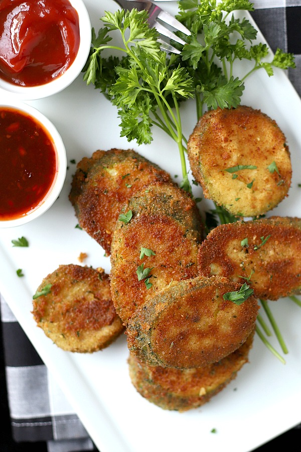 A summertime favorite, breaded fried zucchini is a great side or appetizer. Easy recipe using just a few ingredients and cooked in a skillet until golden brown and crispy.