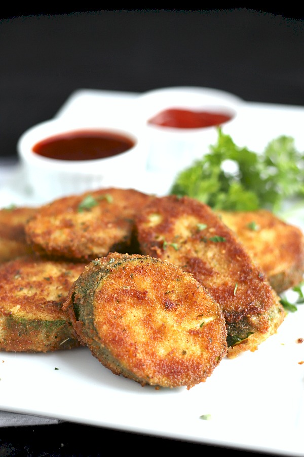 The crispy and delicious coating makes breaded fried zucchini a favorite appetizer or side dish. Just a few ingredients and a few minutes in the skillet until golden brown.