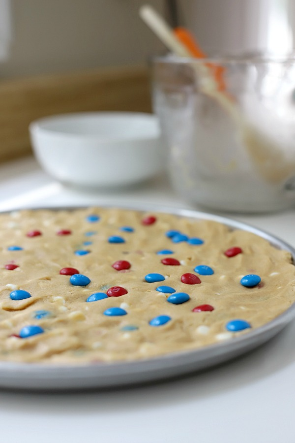 Celebrate the 4th of July with a giant patriotic peanut butter cookie pizza. Easy recipe the whole family will love.