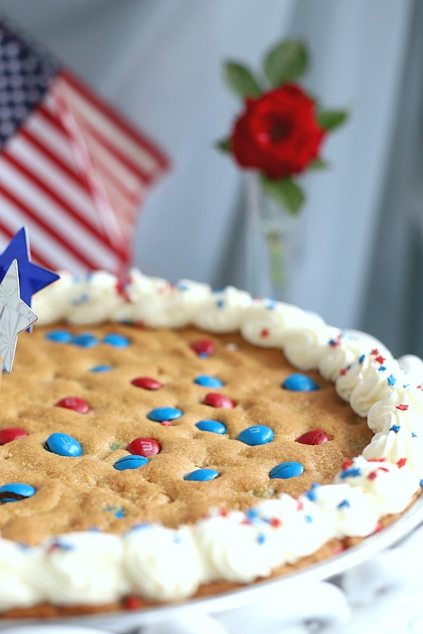 An easy recipe for family parties to celebrate the 4th of July the whole family will love. Patriotic peanut butter cookie pizza is simple and festive for 4th of July, summer entertaining or birthdays.
