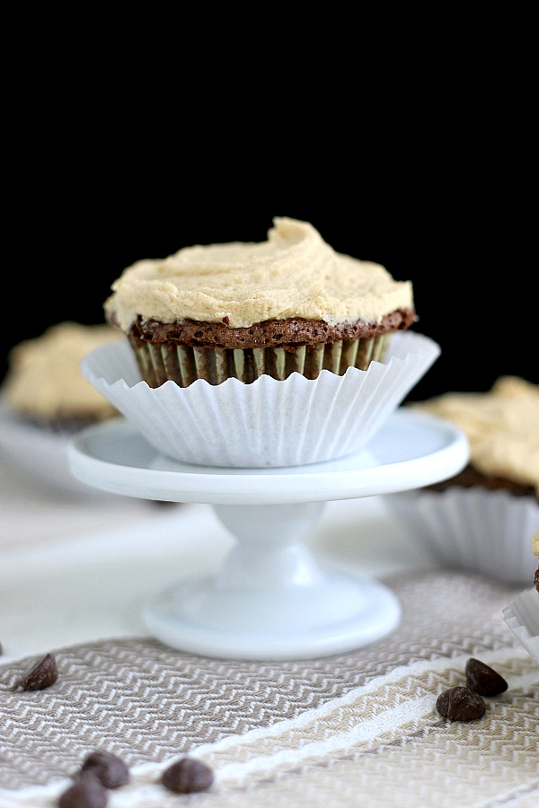 Easy recipe for a moist and decadent chocolate zucchini cupcakes pairs perfectly with peanut butter frosting for a special dessert. No one will even notice the healthy zucchini in the batter.