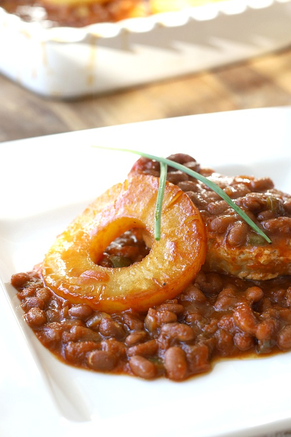 Hawaiian pork chops and baked beans are quick and easy to prepare. Pineapple, brown sugar and molasses give tons of sweet flavor. Great weeknight dinner or potluck dish!