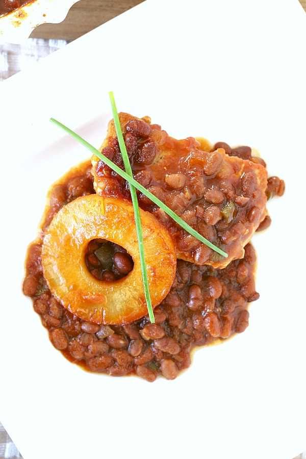 Serve Hawaiian pork chops and baked beans as an easy weeknight dinner or take to your next potluck. Pineapple, brown sugar and molasses gives tons of sweet flavor your family will love!