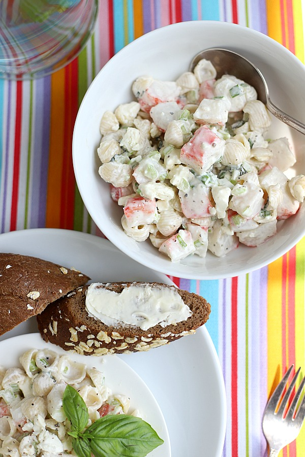 A light and satisfying lunch or dinner, pasta crab salad is a combo of imitation crab with chopped veggies, basil and feta cheese in light dressing. An easy, inexpensive seafood recipe.