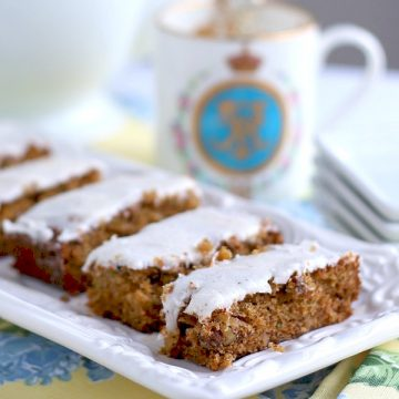 Moist and delicious Zucchini Bars with Spice Frosting pack a lot of flavor in each piece. The frosting has a hint of cloves that perfectly complements and makes them irresistible.