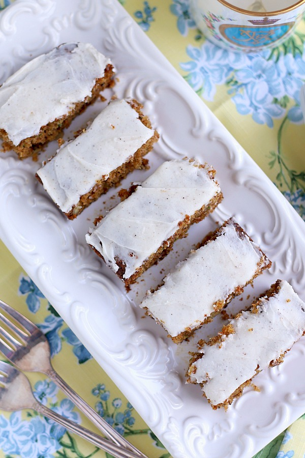 Zucchini bars with spice frosting are moist, delicious pack a lot of flavor in each piece. The frosting has a hint of cloves that perfectly complements and makes them irresistible.