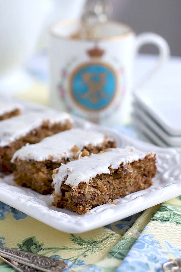 Perfect flavor combo in these zucchini bars with spice frosting are so moist and delicious. Easy recipe with cinnamon and a hint of cloves. A yummy dessert or coffee break treat.