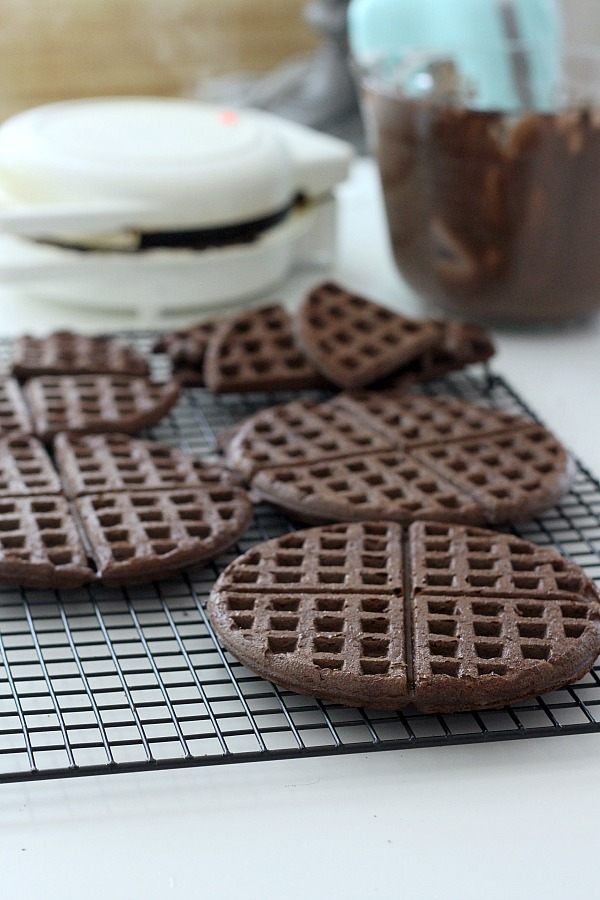 Cake Mix Chocolate Waffles filled with ice cream and dipped in sprinkles are an easy to make dessert and a fun change from birthday cupcakes.
