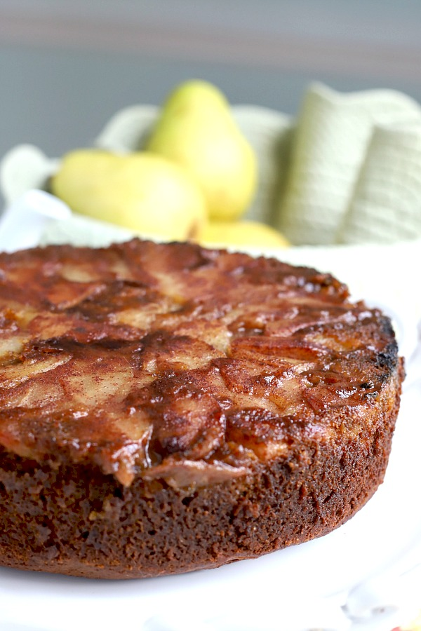 Spiced Pear Upside Down Cake is a deliciously moist cake with the wonderful flavors of cinnamon, cloves, ginger, nutmeg. Topped with caramelized pears and perfect fall or Thanksgiving dessert.