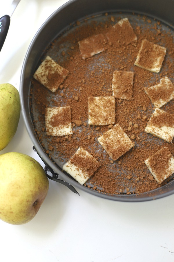 Easy step-by-step recipe for spiced pear upside down cake. Caramelized pears top a moist cake with wonderful spices so perfect for fall and Thanksgiving dessert.