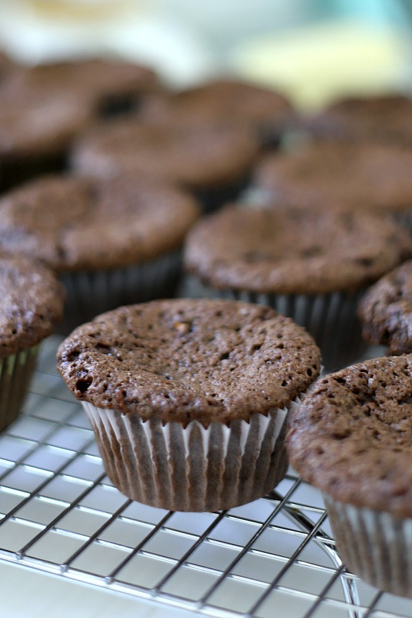 Easy step-by-step recipe for making super moist chocolate zucchini cupcakes with a creamy peanut butter frosting.