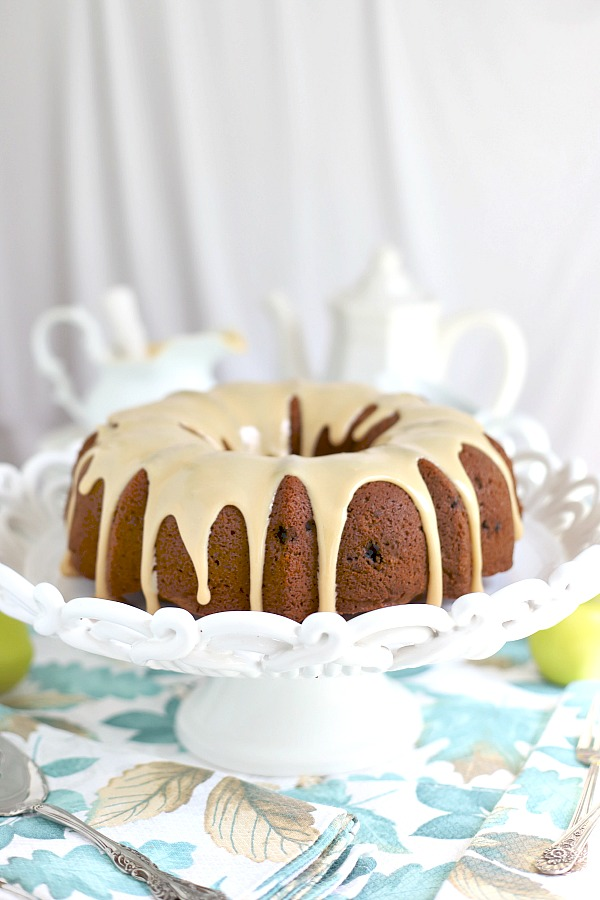 Easy recipe for old-fashioned applesauce cake with over-the-top delicious caramel spread. A perfectly spiced fall dessert that is exceptionally moist.