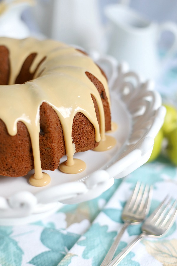 A topping of sweet caramel makes this already moist and delicious applesauce cake extra special. An easy recipe, old-fashioned Bundt cake is a perfectly spiced fall dessert.