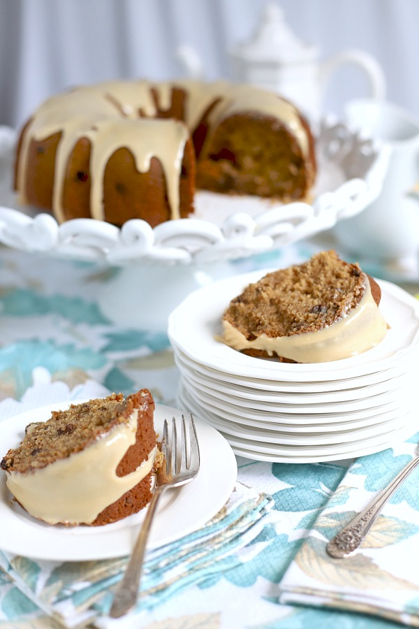 Applesauce cake, from and old-fashioned recipe is moist and delicious with a sweet caramel topping. A perfectly spiced fall dessert made in a Bundt pan.