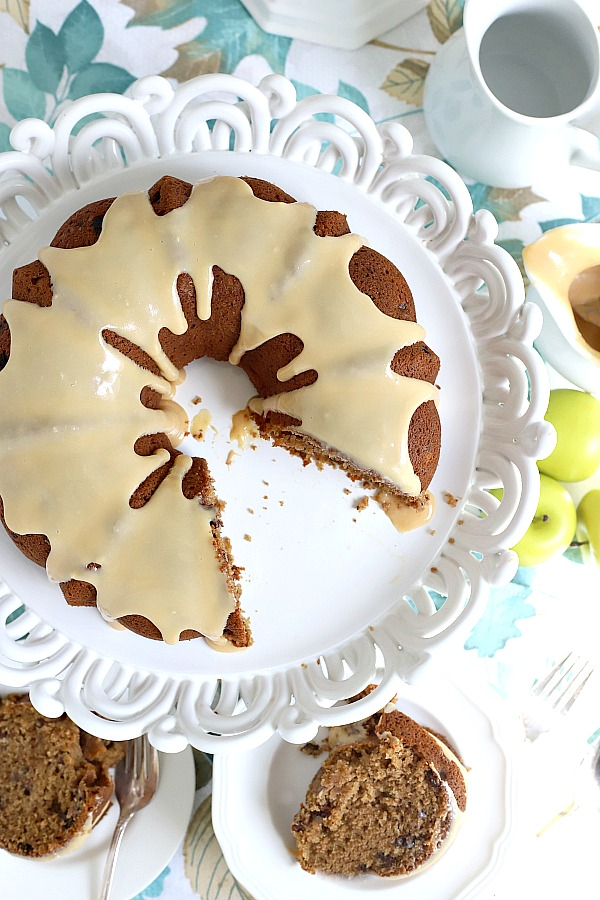 Moist and delicious, applesauce cake is amazing with a caramel topping! Easy, old-fashioned recipe perfectly spiced fall dessert.