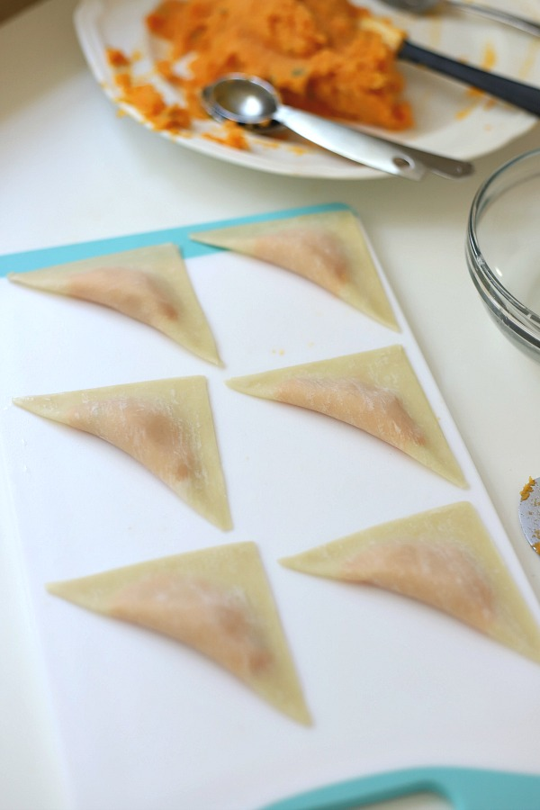 Sweet potato ravioli are pouches of filling in wonton wrappers, served with sage infused cream. An elegant vegetarian dinner entrée sure to please!