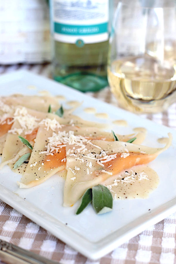 Sweet potato ravioli are delicious little pouches of sweet potato filling in wonton wrappers and served on a plate of cream infused with sage. A lovely vegetarian dinner entrée or for celebrating a special occasion and vegetarian friendly!