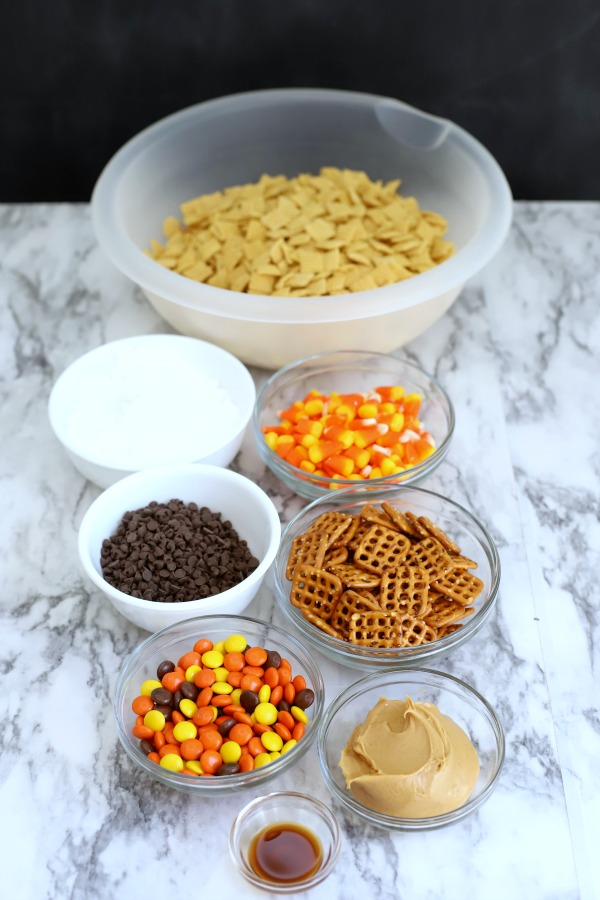 Easy to make, autumn puppy chow is a kid and adult favorite Halloween party snack. Chex mix, chocolate, peanut butter and candy corn tossed with confectioners sugar is a frightfully delicious concoction!