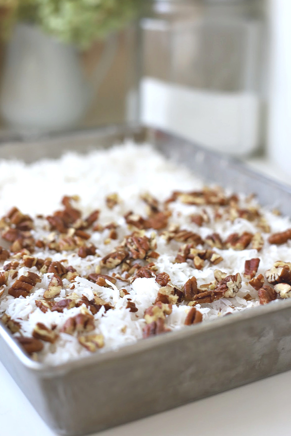Easy recipe for cherry pineapple cabana cake with toasted coconut and nuts. A perfect dump cake dessert for any occasion.