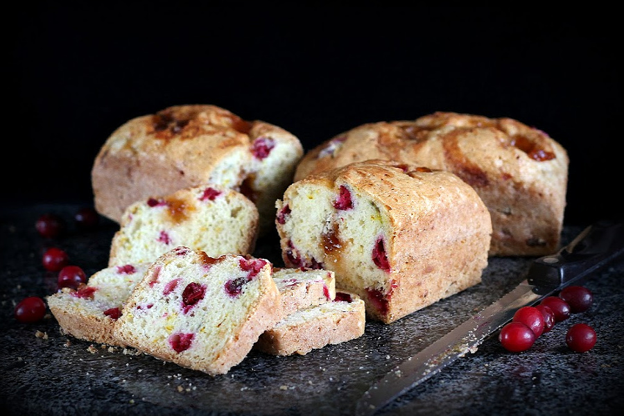 Add a moist and delicious frosted apricot cranberry bread to your Thanksgiving dinner menu. Pieces of tart cranberries and swirls of sweet apricot preserves combine to make a lovely holiday bread. Makes 1 standard loaf of three mini loaves.