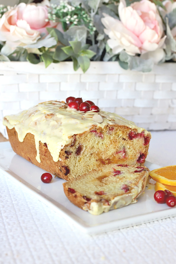 A delicious  idea for your Thanksgiving dinner, frosted apricot cranberry bread is moist and so good. With the orange frosting, it is almost like dessert. And, because it is a quick bread it is an easy recipe.