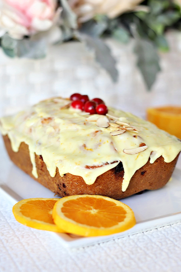 A quick and easy bread, frosted apricot cranberry bread is filled with pieces of chopped cranberries, swirls of apricot preserves and a sweet orange frosting. A perfect side for your Thanksgiving or holiday dinner.