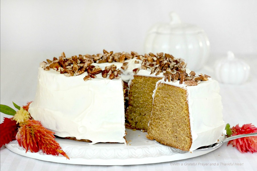 Pumpkin Pound Cake with Cream Cheese Frosting and topped with pecans.