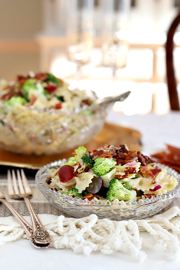 Broccoli grape pasta salad is a tasty and colorful side dish, lunch entrée or light dinner meal. Tender pasta is tossed with a creamy, sweet and tangy dressing and topped with toasted pecans and crisp bacon.