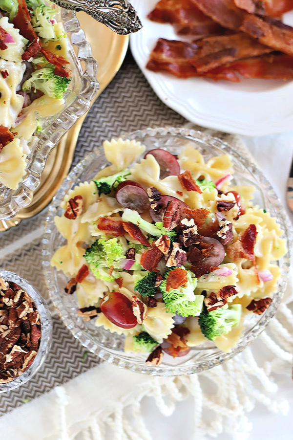 Easy recipe for Broccoli Grape Pasta Salad. Tender bow tie pasta with fresh broccoli, grapes in a sweet and tangy dressing topped with toasted pecans and crisp bacon. It is a perfect side dish, lunch or light dinner.