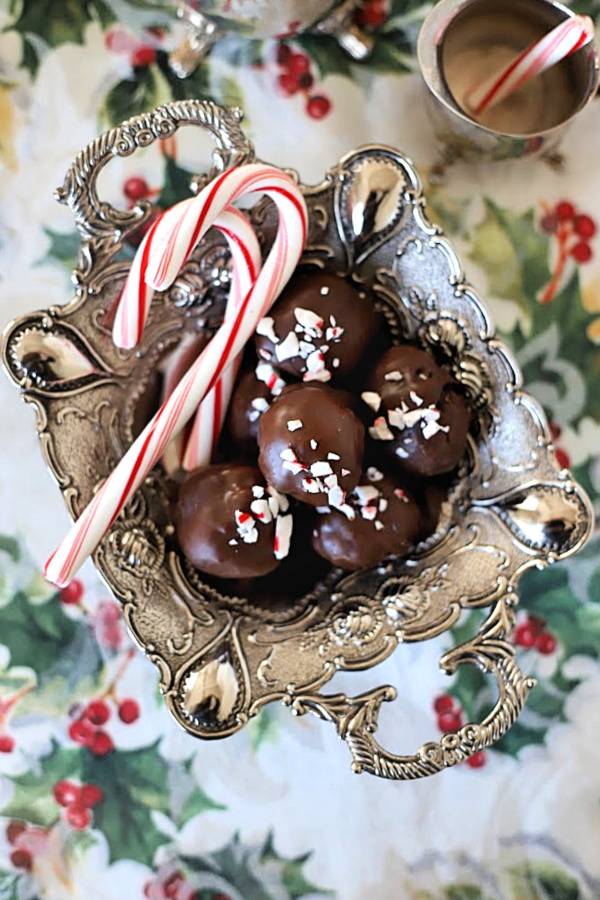 Easy yet elegant recipe for Oreo cookie balls begins with just three ingredients! Mix, shape and dip in melted chocolate. A yummy no-bake Christmas treat.