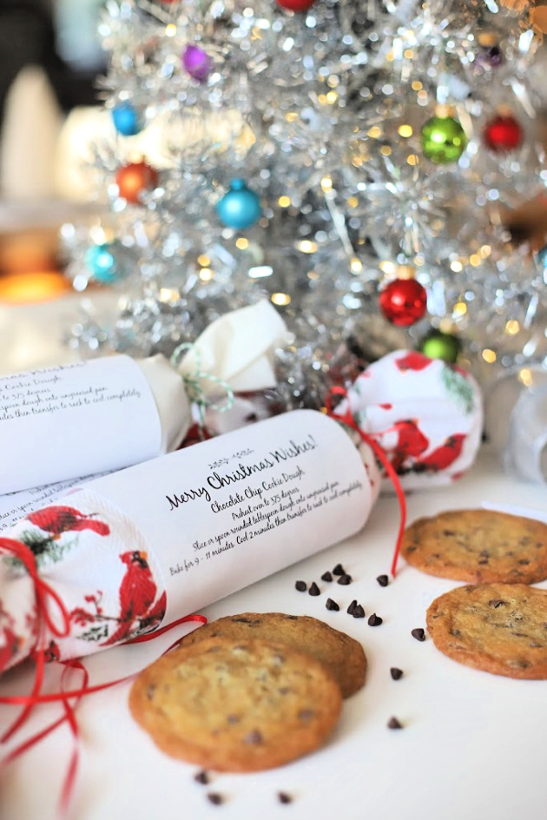 Make delicious holiday gifts from your kitchen. Easy recipe for chocolate chip cookie dough in festive packaging is frozen and ready to slice and bake for homemade cookies without the work. Perfect for teachers, neighbors and coworkers.