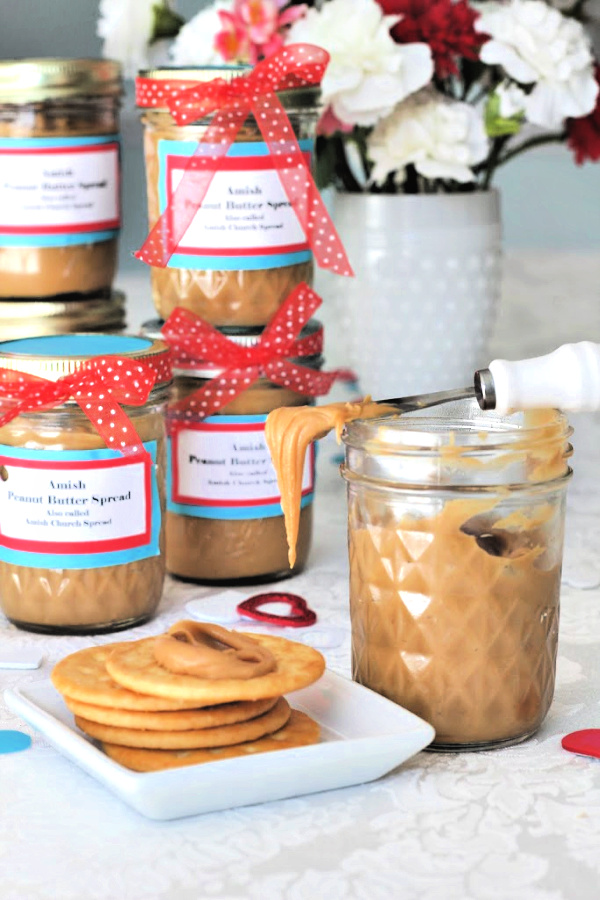 Dress up a jar of homemade Amish peanut butter church spread with a ribbon and tag for a perfect Valentine's Day gift for a friend or coworker. Sweet and creamy spread so good on crackers, bread, muffins and so much more!