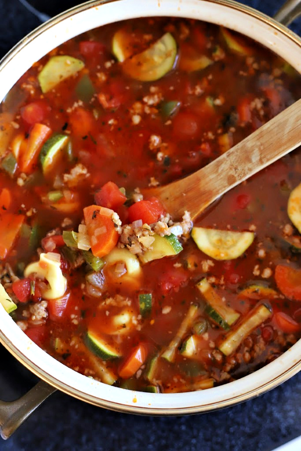 Easy recipe for robust and flavorful Italian sausage soup is a meal in a bowl. Tender vegetables with sausage and tortellini in a tomato broth will warm you soul and tummy.