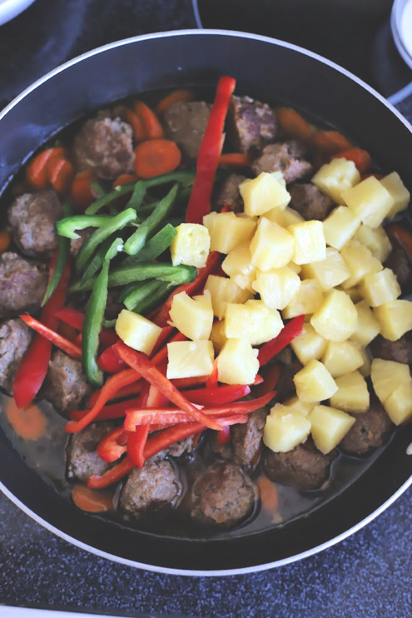 Easy recipe for Sweet and sour meatballs. Bell peppers and carrots are cooked crisp tender and added with pineapple chunks to a lightly tangy sauce. Serve over rice for a great weeknight or family dinner.