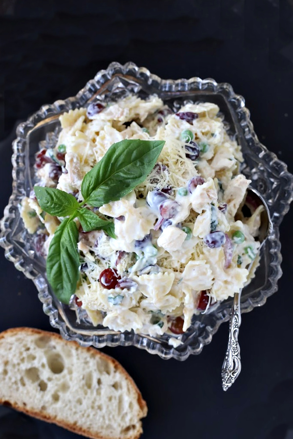 A favorite, creamy chicken pasta salad with parmesan cheese, peas and basil is perfect for potluck food, tasty lunch entrée, cookout side dish or a tasty dinner. So much goodness, it is a meal in itself. Serve with crusty bread and enjoy!