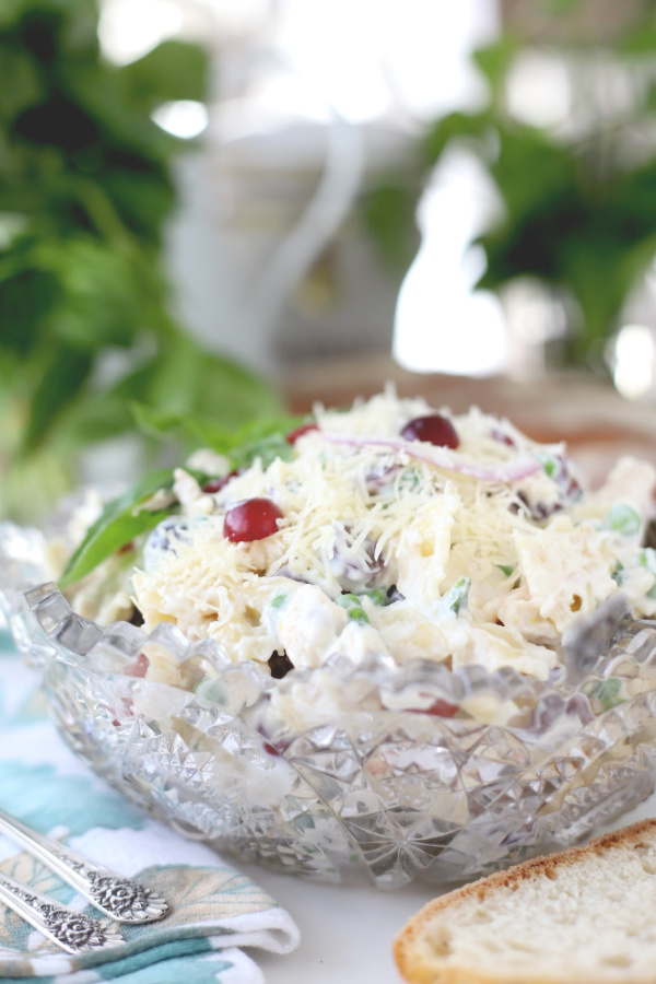 Chunks of chicken, bow tie pasta, Parmesan cheese, grapes and veggies are tossed together and then refrigerated a few hours for all of the flavors to blend and meld together. With a hint of lemon for brightness and, my personal favorite, basil, it is a bowlful of creamy deliciousness.
