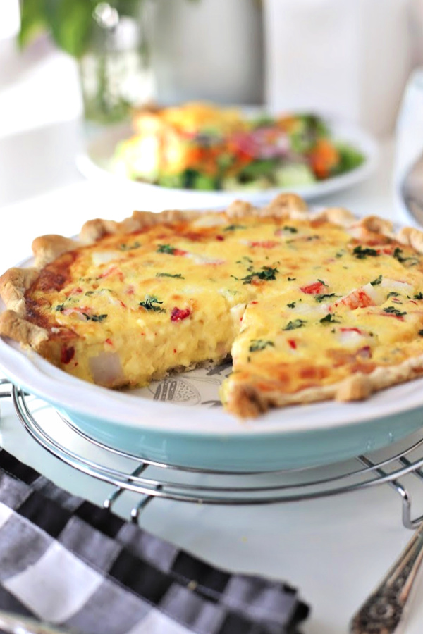 An easy French tart, crab quiche consists of a bottom crust and filled with a savory egg and cream custard with crab or imitation seafood. It is baked and can be served either hot, room temperature or cold. Perfect for brunch or dinner.
