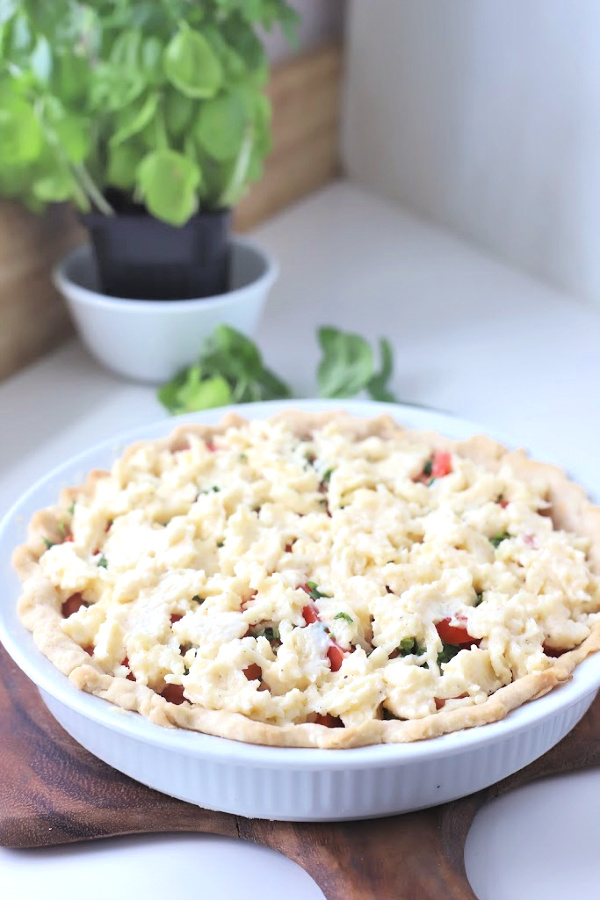 There is something about the flavor combo of fresh tomatoes and basil. An easy recipe that combines creamy Mozzarella and Parmesan cheese in a flaky crust. Basil tomato pie is bright, savoryand delicious! Serve as an appetizer or entrée.