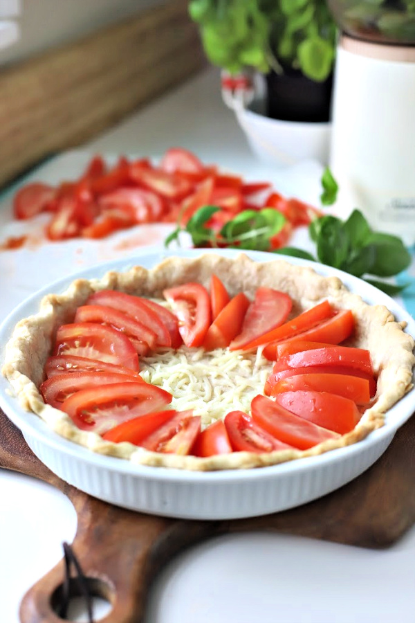 There is something about the flavor combo of fresh tomatoes and basil. An easy recipe that combines creamy Mozzarella and Parmesan cheese in a flaky crust. Basil tomato pie is bright, savory and delicious! Serve as an appetizer or entrée.