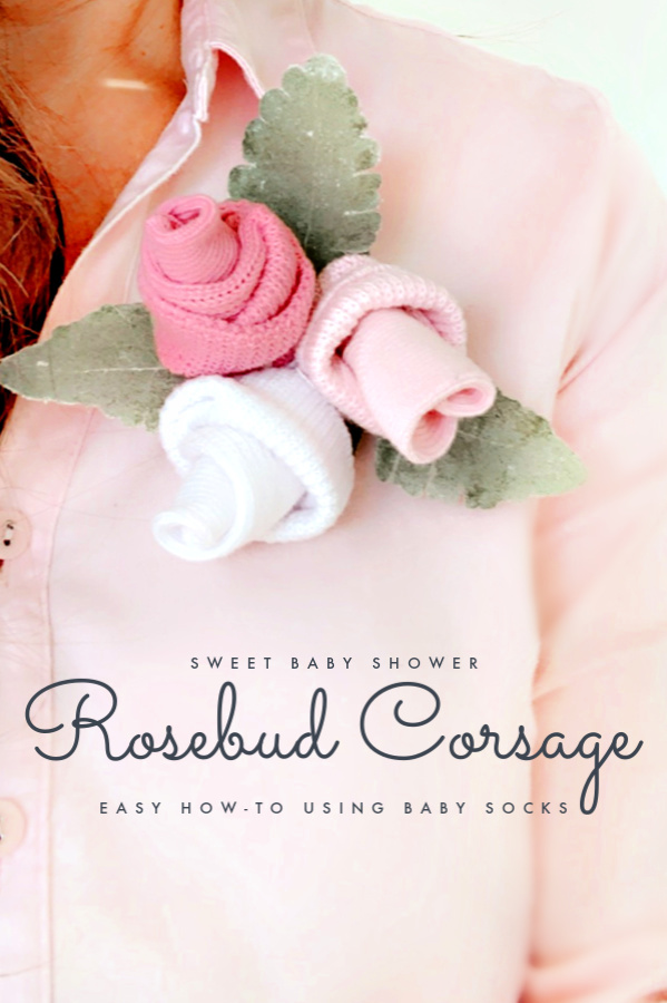 Sweet rose baby sock corsage is a lovely idea for the Mom-to-Be at her baby shower. Easy DIY rosebud how-to posy.