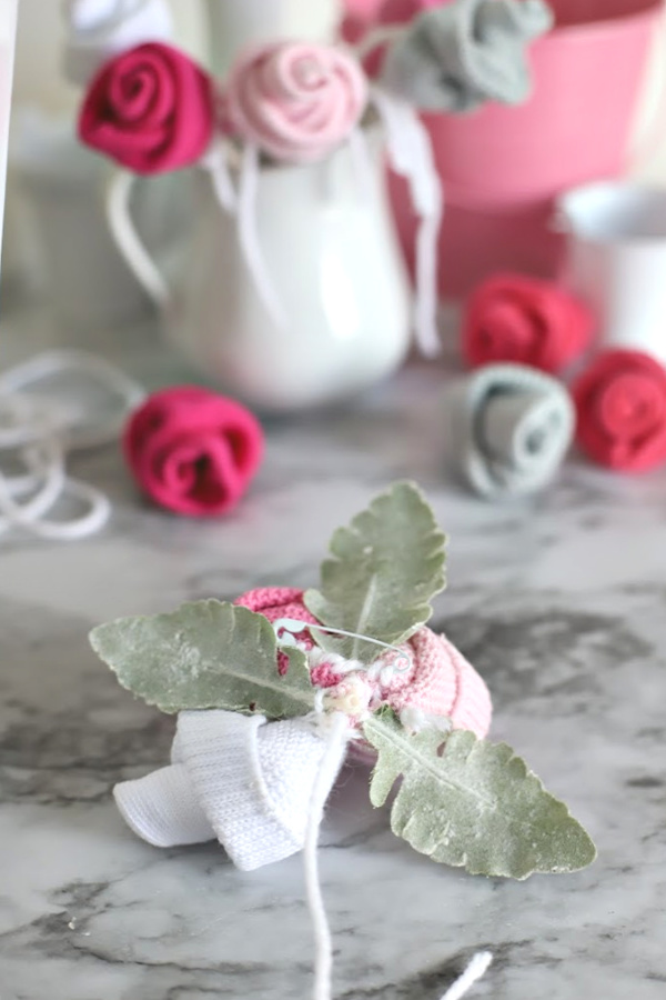 Easy step-by-step how-to for bud roses from baby socks. DIY flowers for shower corsage and décor ideas.