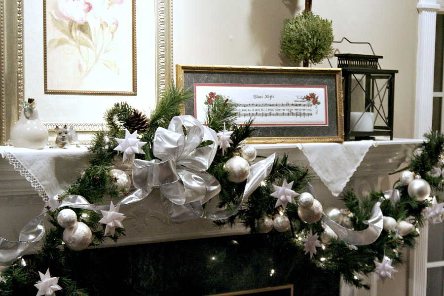Folded paper German Star Christmas holiday mantle décor.