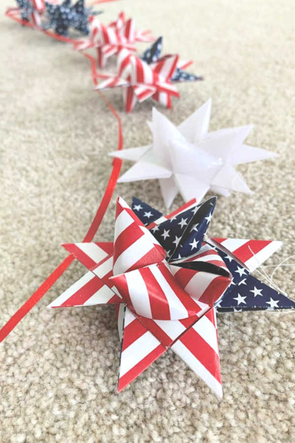Easy step-by-step video tutorial how-to for patriotic paper stars perfect for 4th of July, Memorial Day or the military hero in your life. Made by folding and turning strips of paper creating a lovely 16-pointed, three dimensional ornament.
