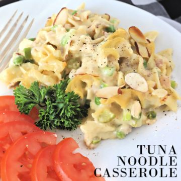 Classic creamy tuna noodle casserole with egg noodles is budget-friendly. Quick and easy recipe using cream of chicken soup, mayo and cheddar cheese.