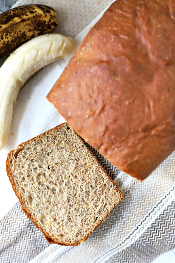 Easy recipe for healthy whole wheat bread with banana and honey. Use a bread machine for dough then shape and bake for a delicious, lightly sweet yeast bread. Slices well for sandwiches and perfect toasted!