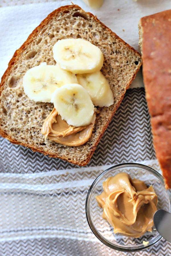 Easy recipe for healthy whole wheat bread with banana and honey. Dough made using a bread machine then shaped and baked for a delicious, lightly sweet yeast bread. Slices well for sandwiches and perfect spread with peanut butter!