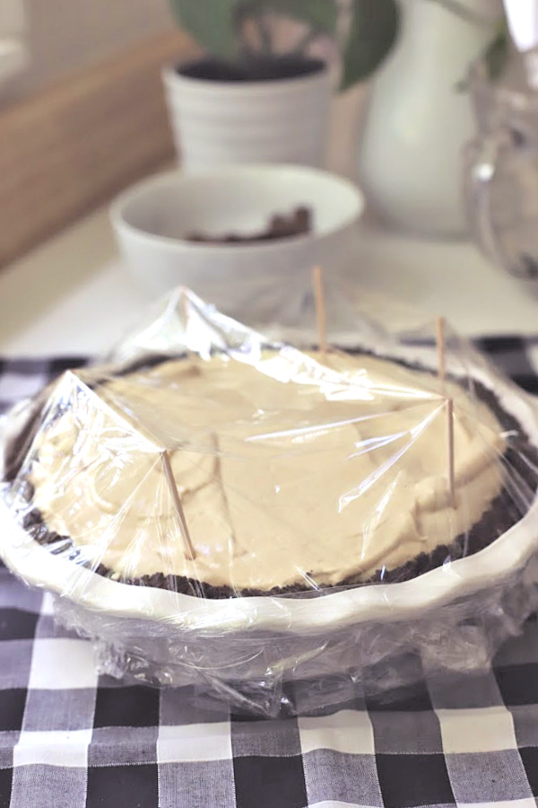 Easy recipe for no-bake peanut butter pie with cream cheese and whipped topping in a heavenly chocolate crust. Creamy, frosty and easily made from scratch!